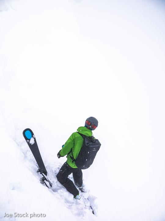 Mike Bromberg searches for the entrance. Revelstoke, British Columbia.