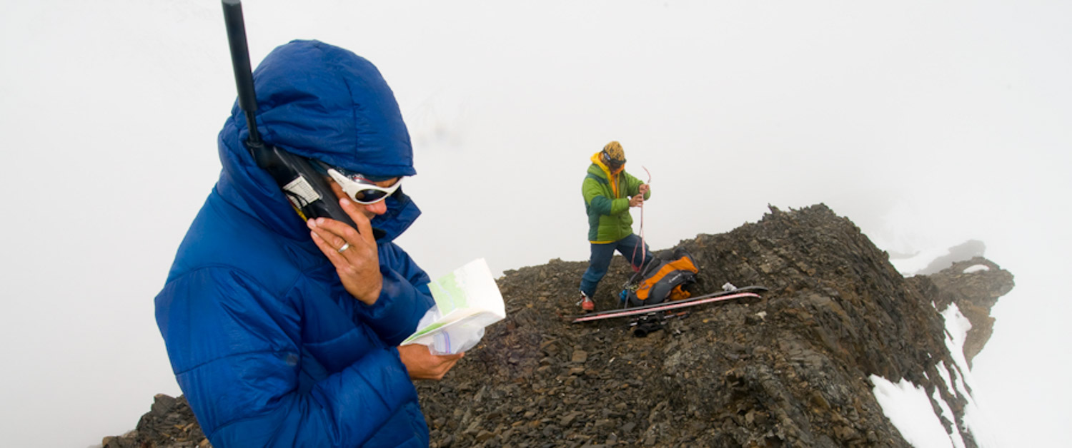 Joe calling Meekin Air Service at the north end of the Tordrillo Mountains, Alaska. Photo by Dylan Taylor.