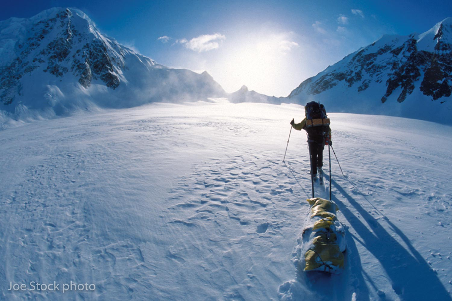 Dylan sledging up the Valdez Glacier toward Cacheman Col on day two.