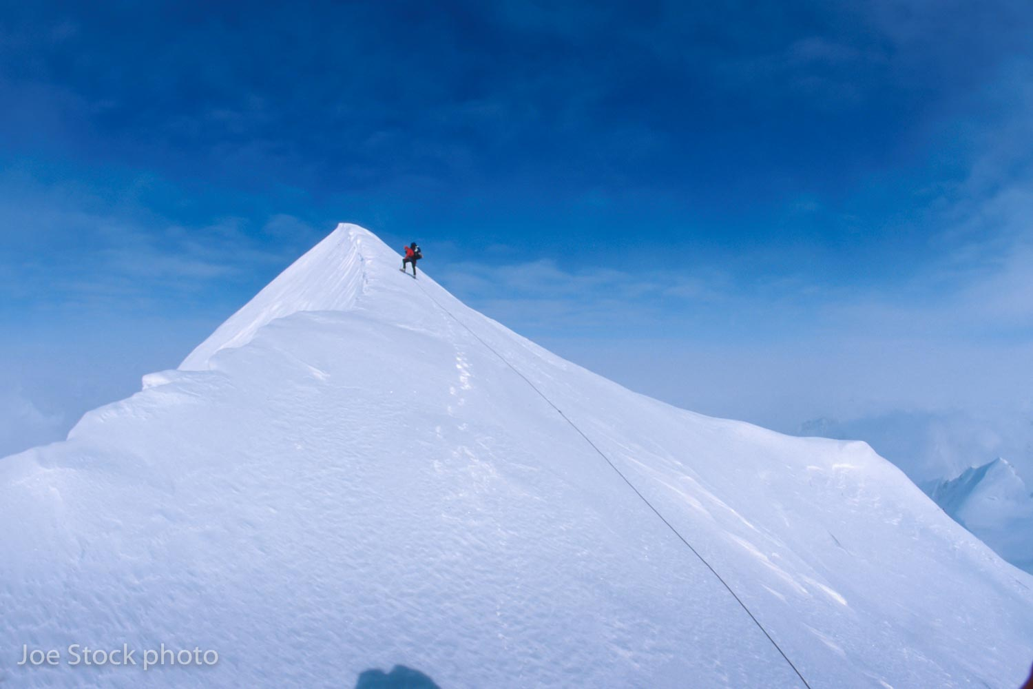 Dylan on the summit of Mount Thor (12,251'), the second highest summit in the Chugach Mountains.