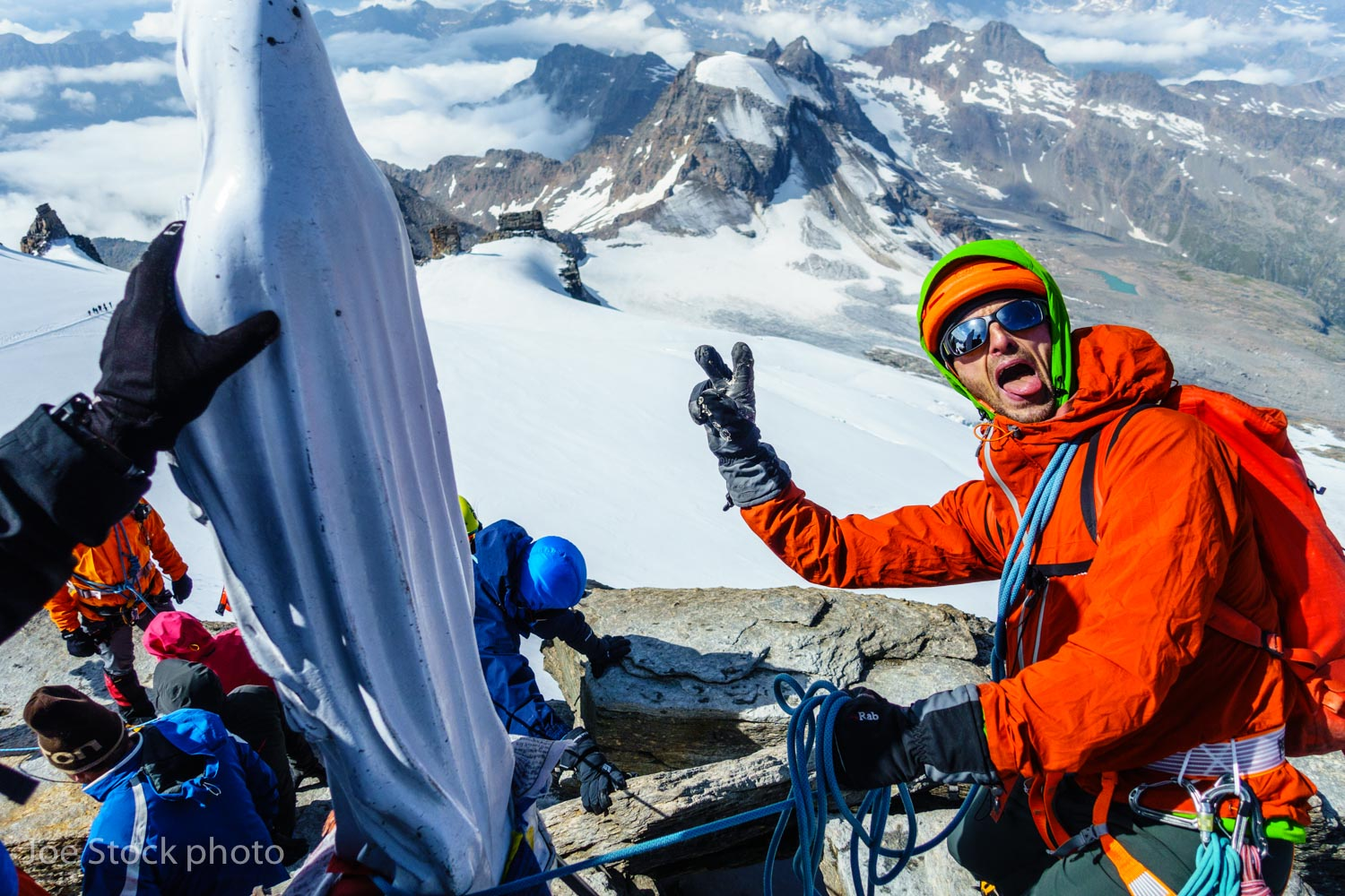 Aspirant guide James Clapham using the Madonna as a sacrilegious short pitch horn on the summit of the Gran Paradiso, the highest point in Italy.