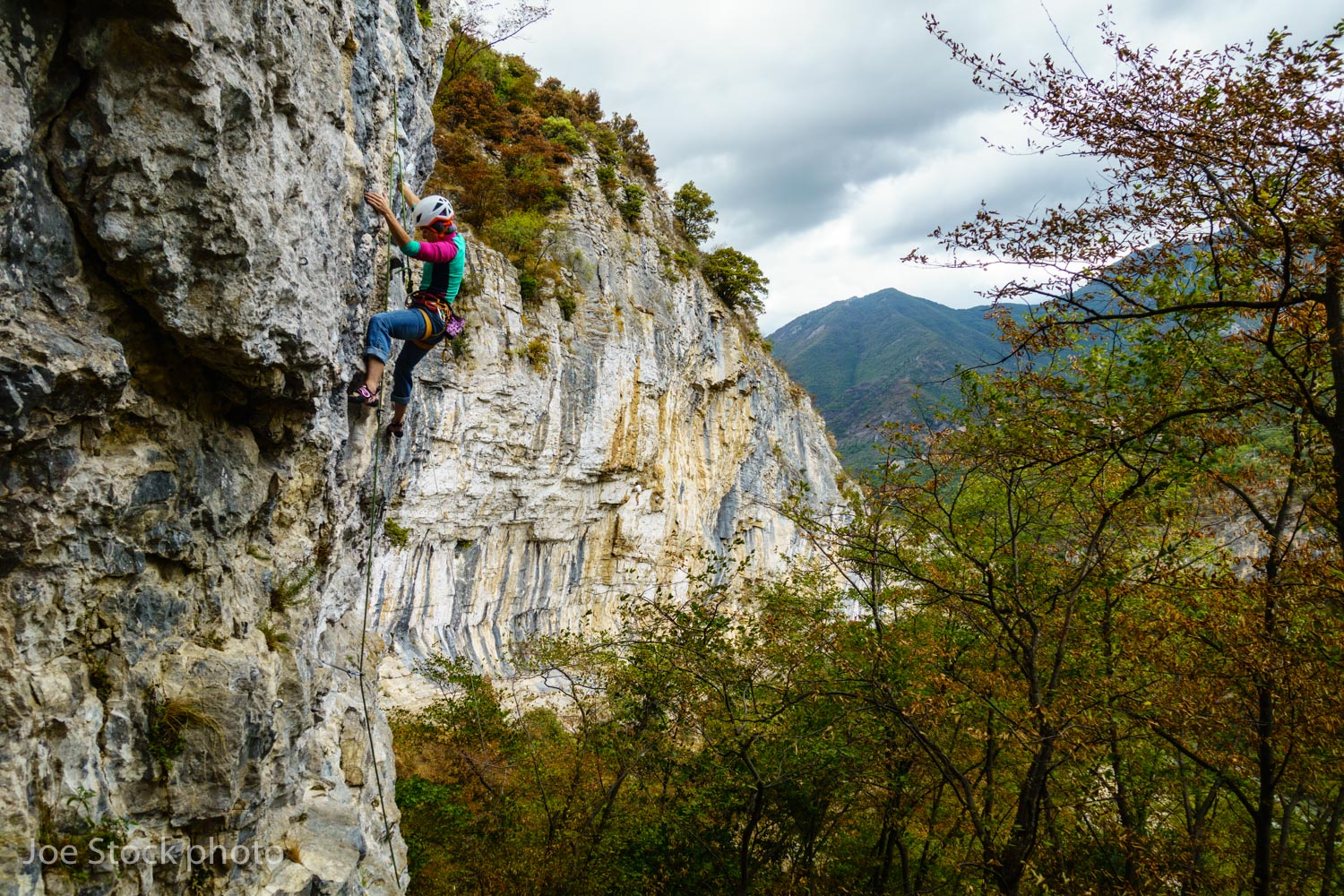 Cathy climbing in Oltre Finale, belayed by Andrew. Finale is on the Mediterranean, where the weather is always better.