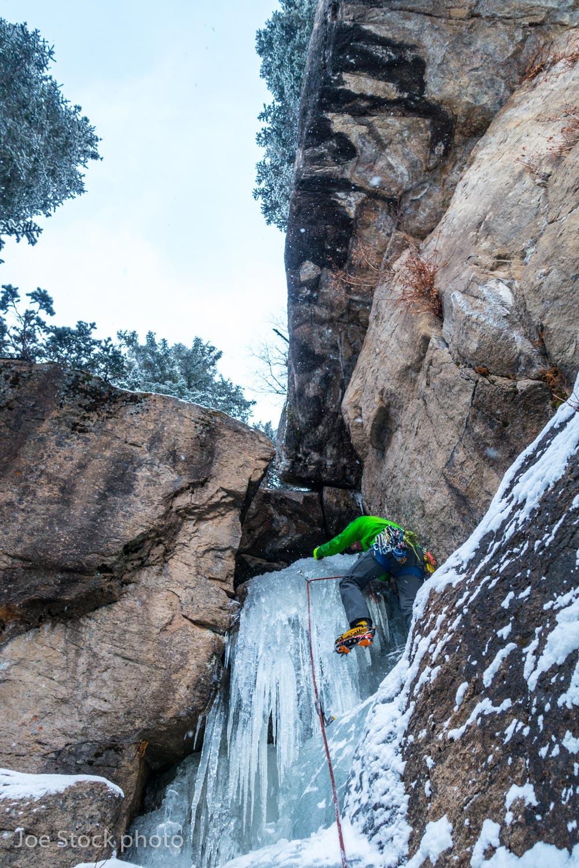 Alan leading ice tiers and rock chockstones near Hidden Falls.