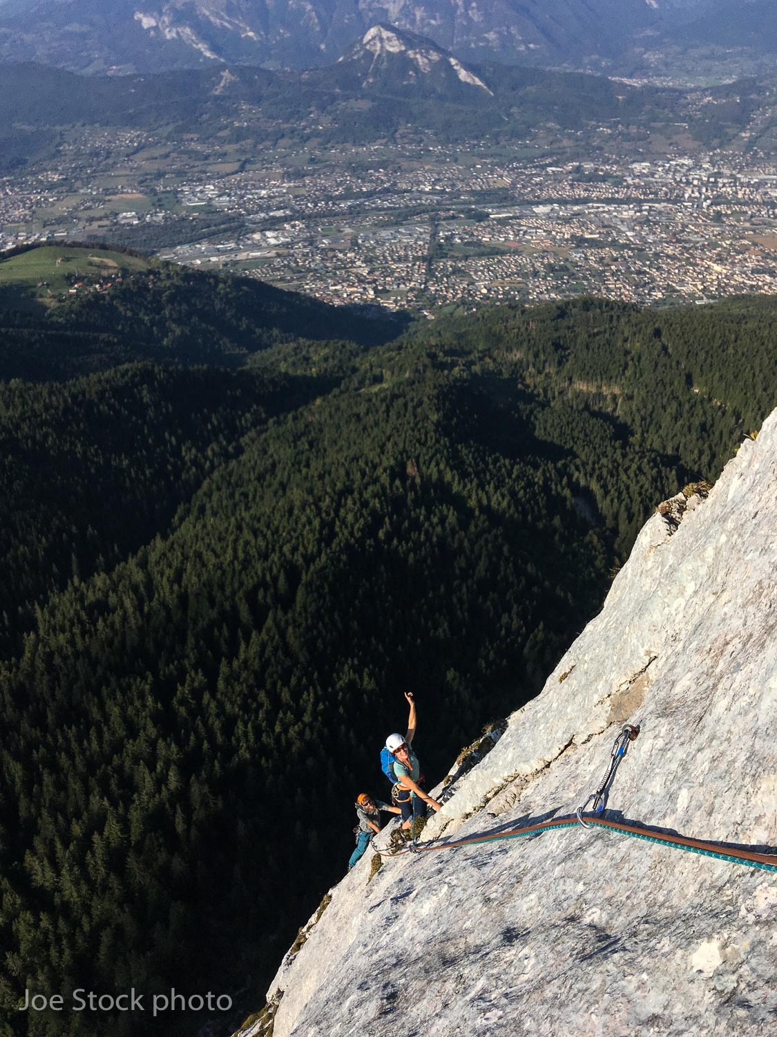 Chris Simmons and Cathy Flanagan above the town of Cluses on Variante à Pétiole on Petite Bargy, a 10-pitch, 300-meter, 5.10a with a walk off.
