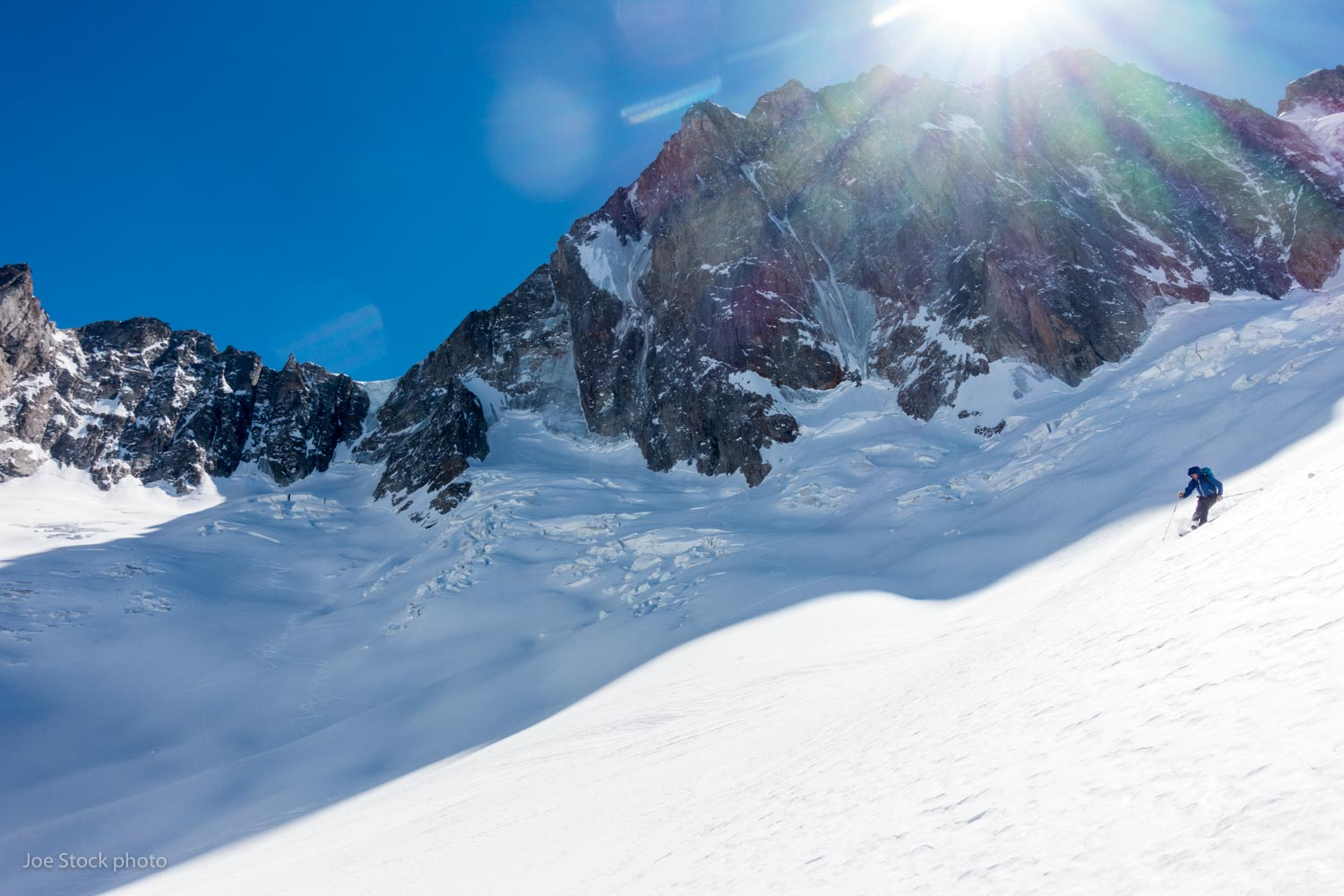 Eric Larson skiing below the 4,000-foot north face of the Grandes Jorasses, one of the six great north faces of the Alps.