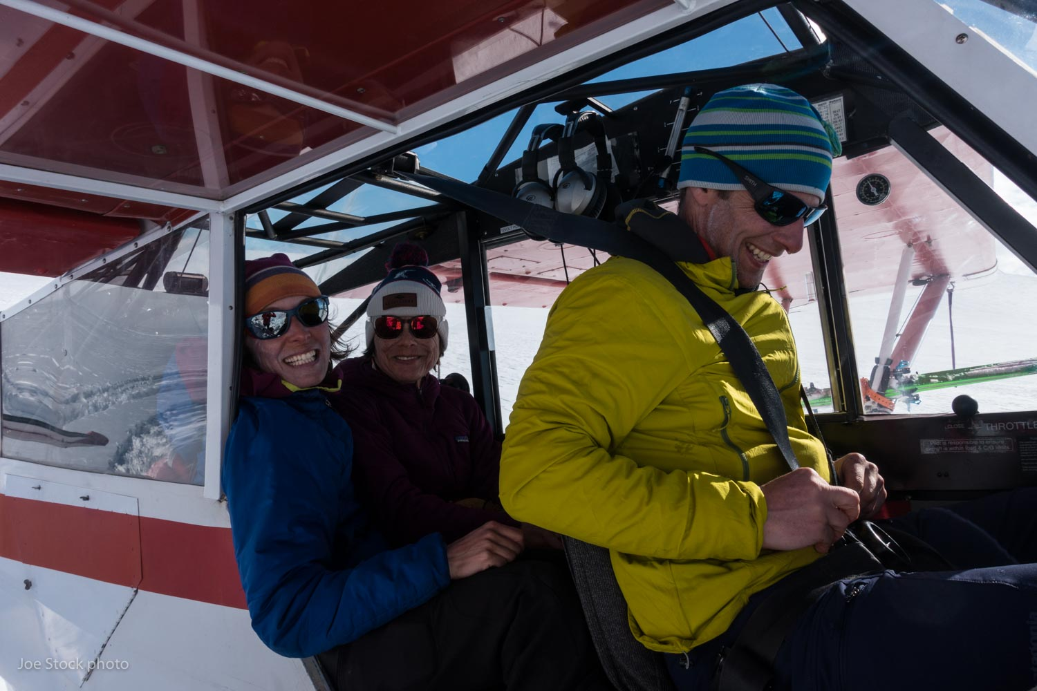 Najeeby and Cathy squish into the back seat of Jeff's Piper Super Cub in Valdez.