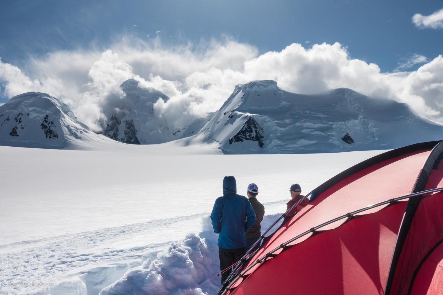 Our camp was perched on a 7,500-foot bench of the Yentna Glacier, surrounded by peaks including the mighty Mount Russell (11,670 feet) at the head of the valley. Denali ranger Tucker Chenoweth calls this location Island in the Skye. His daughter is named Skye. It did feel like an island. There's no easy escape from this island enclosed by rock walls and icefalls.  We chose this place with the help of Steve Gruhn in Anchorage. Steve's our man for adventure. Our plan A idea came from Steve, as well as our plan B.  Weather during the trip was mostly light winds and clear skies. Good weather in this region typically comes with north wind, which flows hundreds of miles across the tundra, then hits the mountains where we camped. The air rises and condenses on the summits around us. It's a rare day without clouds lurking on Mount Russell. Pilot Paul Roderick warned us about the weather in the area. Paul knows.