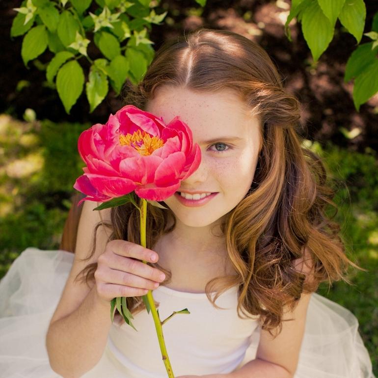 Caroline-with-flower-web.jpg