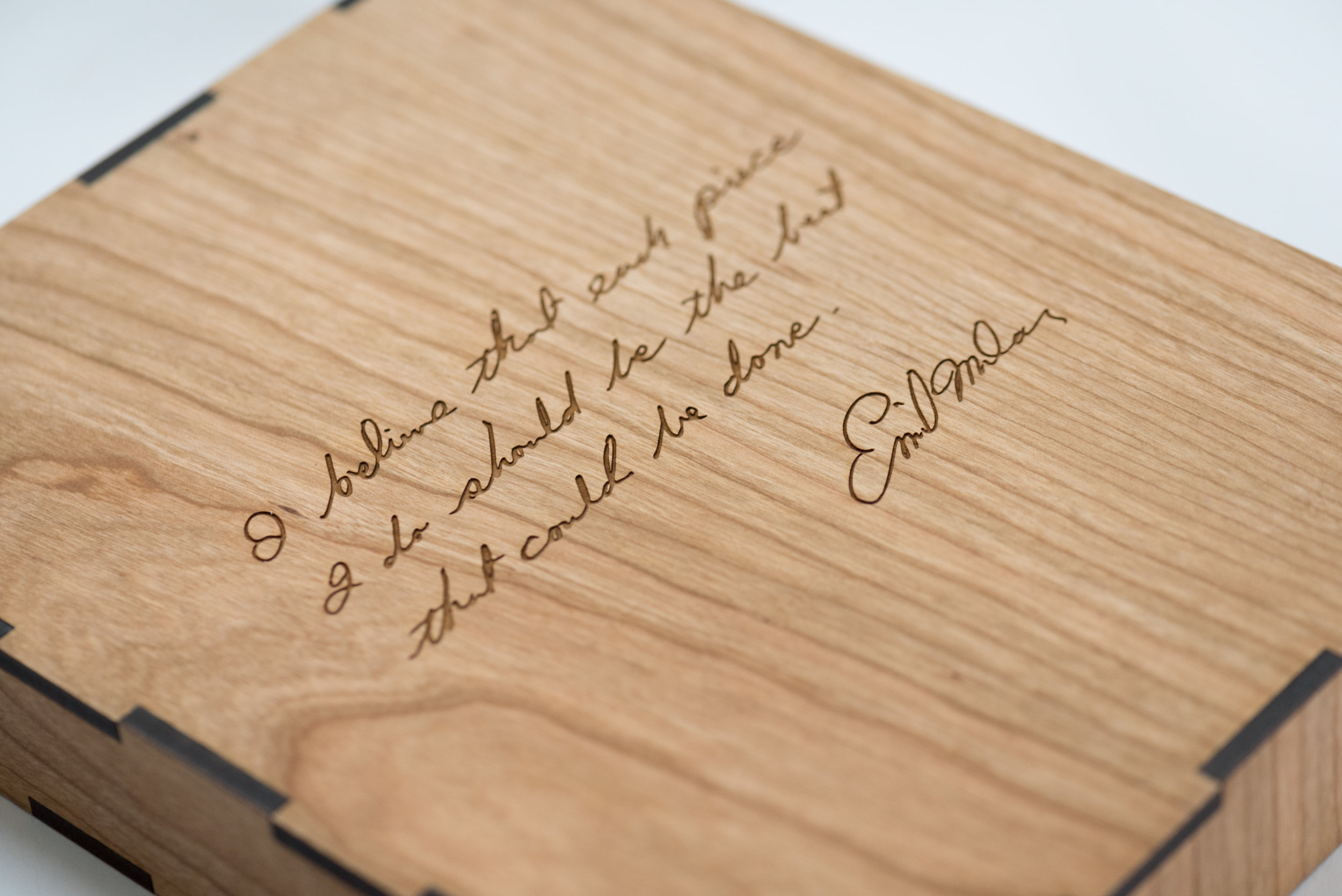 The back of the slip case is adorned with a laser-etched Emil Milan quote.