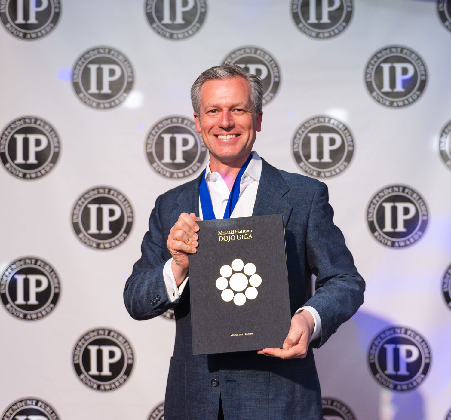 Steve Olsen (writer and publisher) traveled all the way from Japan to receive the gold medal at the 23rd annual Independent Publisher Book Awards ceremony in New York City on May 28, 2019.