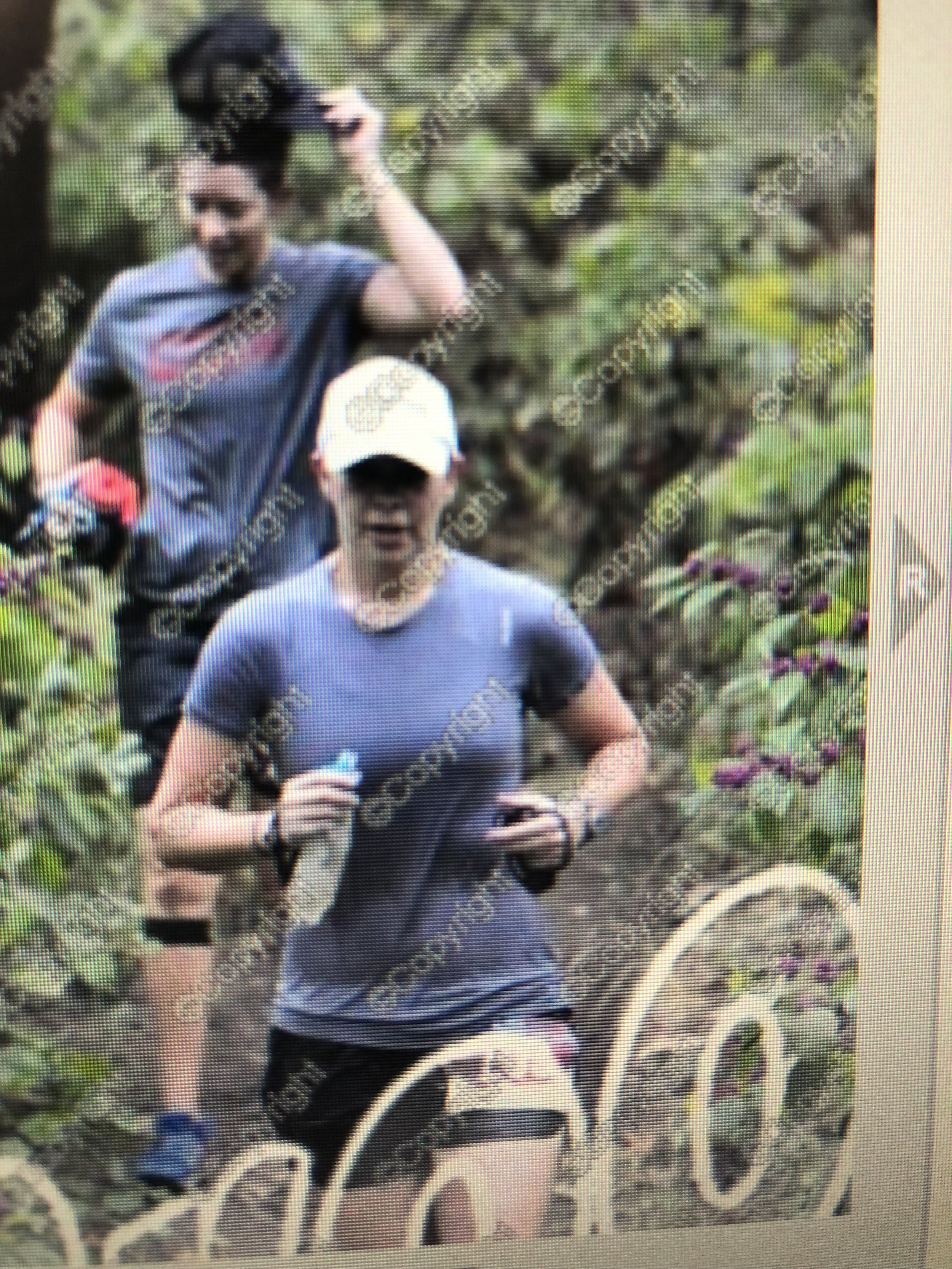 Megan and I finishing up a loop at the 100k - soaked to the bone