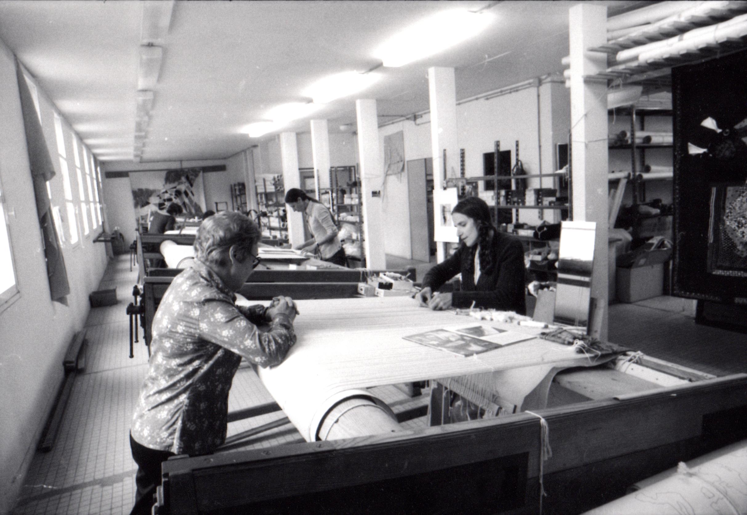June Wayne working alongside master weavers in France