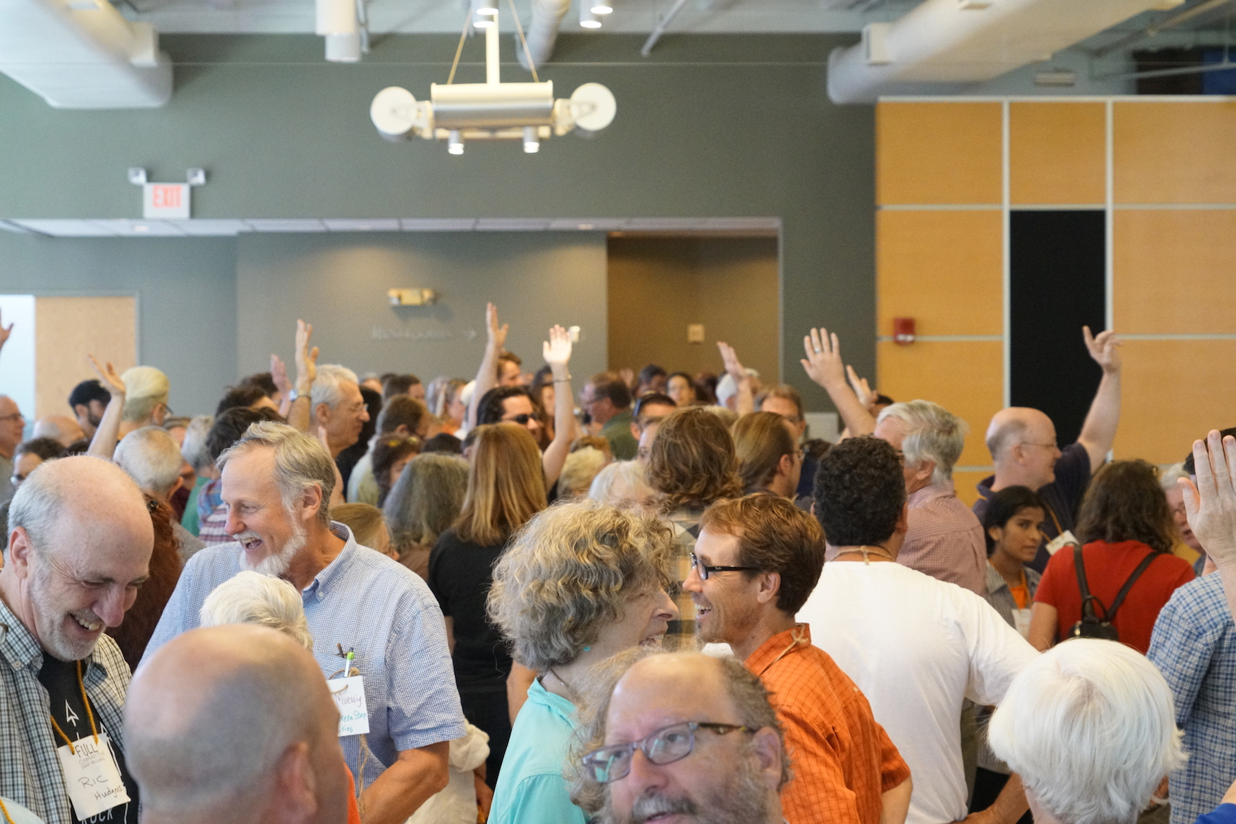 Having fun amidst the chaos of a geographical mapping of all National Gathering participants. Photo by Teresa Konechne.