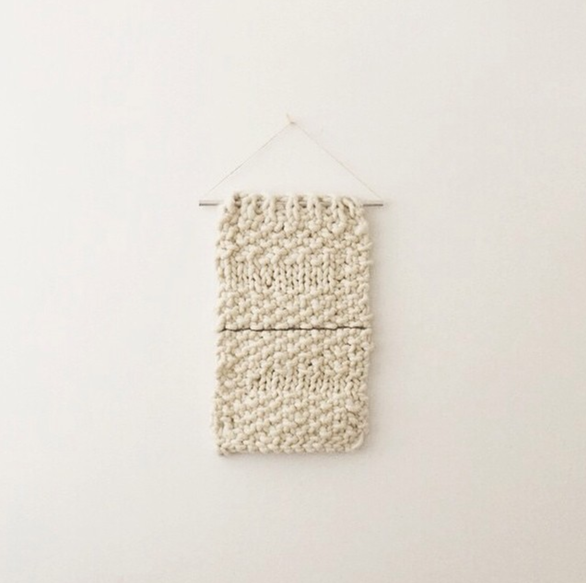 mini wall hanging on steel pole, commissioned for a friend. hand-knit, 100% wool.