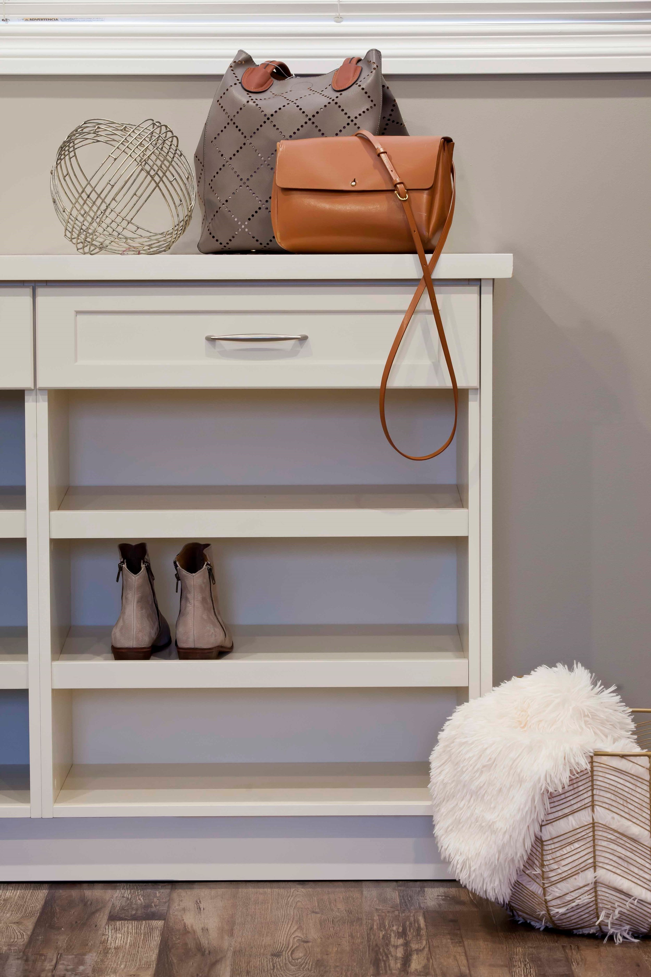The shoe shelves were designed to make use of the space under the window.