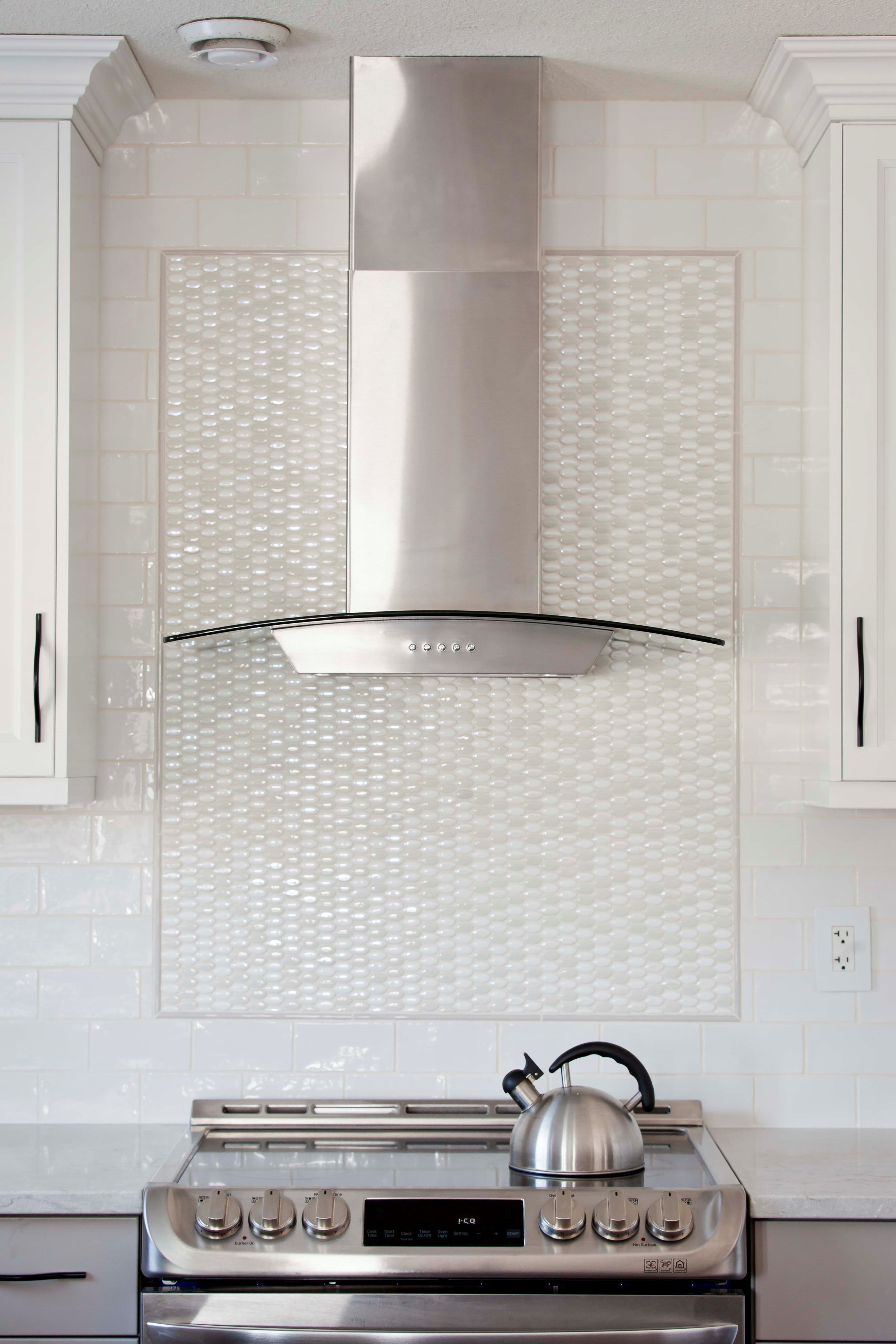 With feature tile work, the cooking area becomes a focal point in the kitchen.