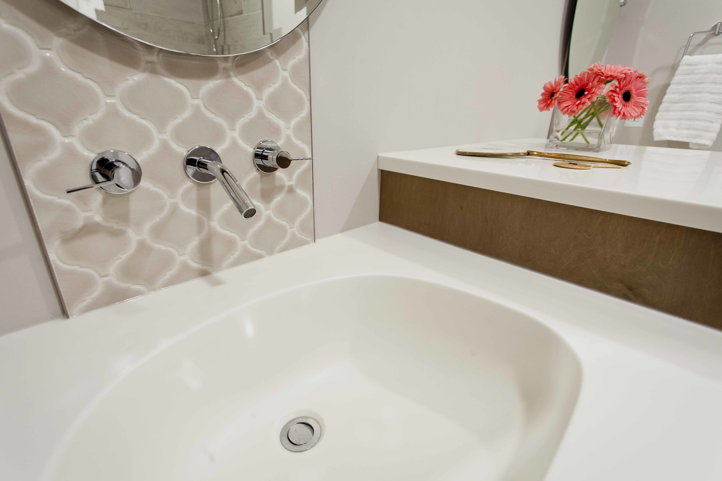 The Moroccan tile is the perfect backdrop to wall-mounted faucets.