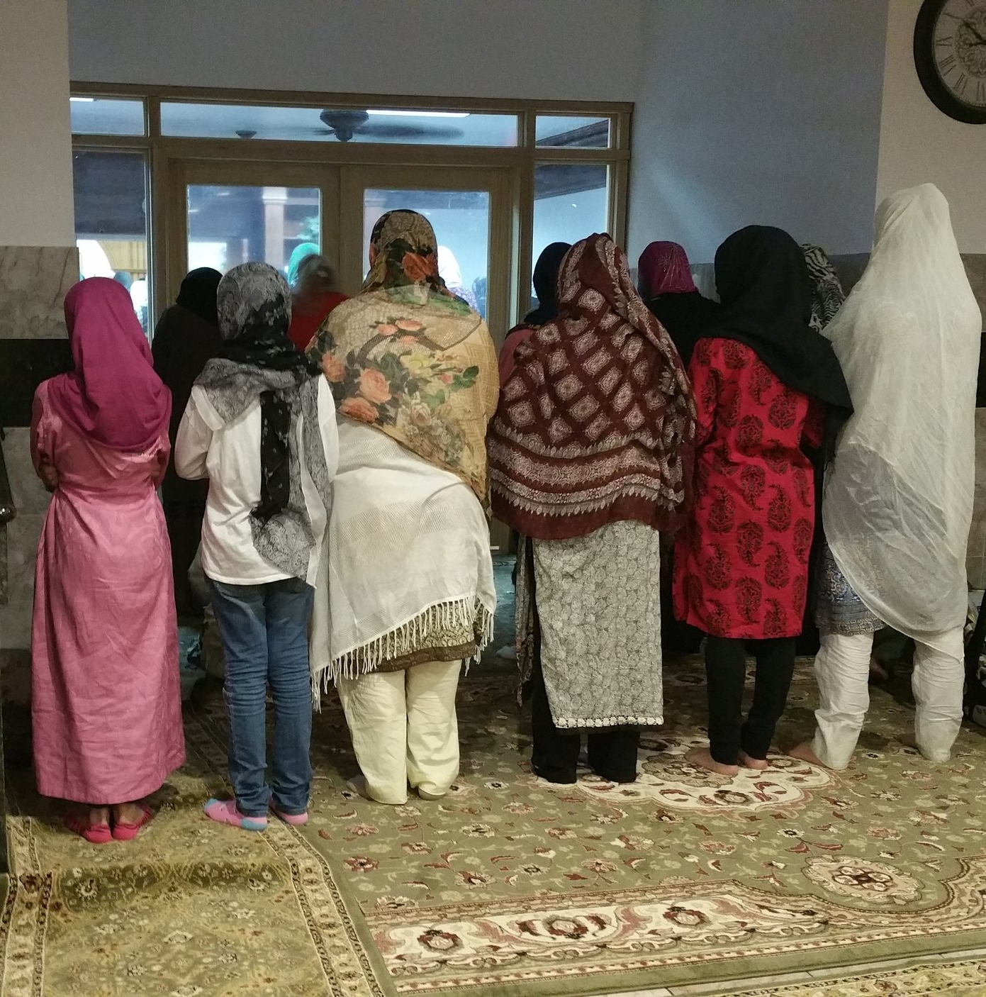 Friends praying in the masjid together during Ramadan