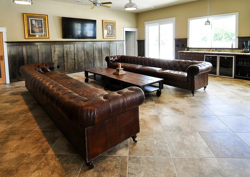 Leather 'cigar' couches in cabana