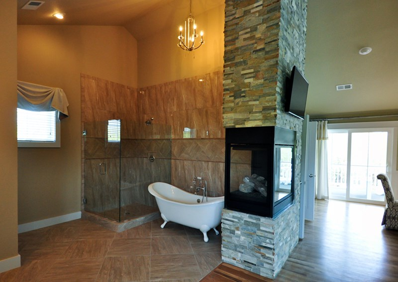 Bridal suite bathroom with see-through fireplace