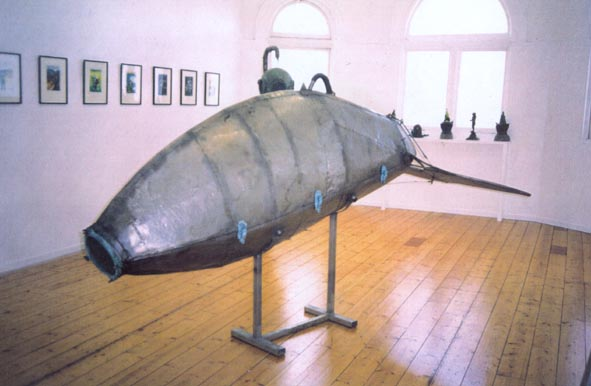 '60 Fathom Dive Suit'  1996, 1.4m by 2.2m by 0.6m, stainless, bronze & glass