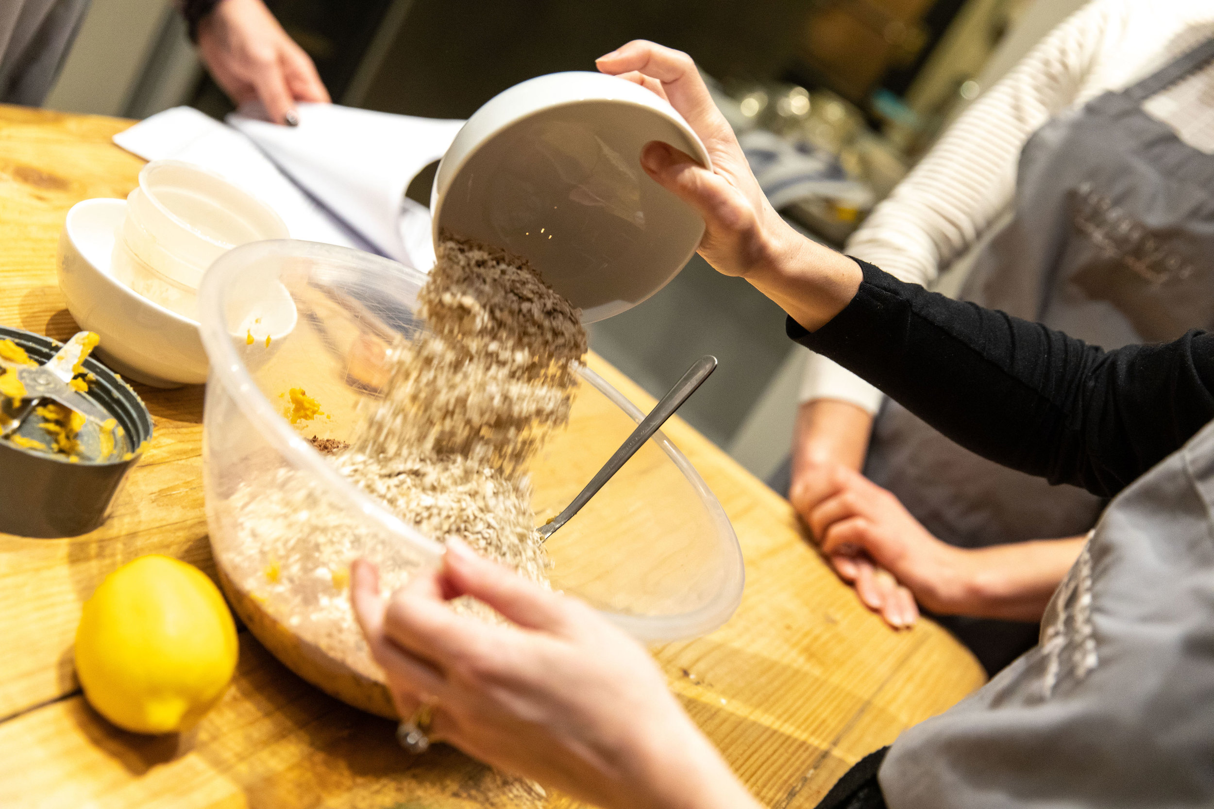 Oats pouring into bowl for sweet potato brownies