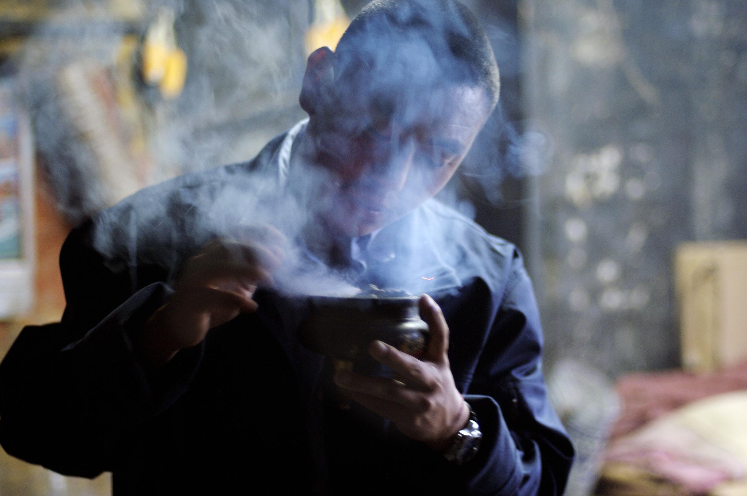 Tshering Penjor    during his Saang, a morning ritual burning incense 09.09.07 Kabji-Thalo, Punakha