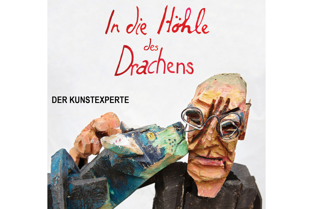 Der Kunstexperte: In die Höhle des Drachens _The Art Critic: Into the Dragon's Den  21 min long short film and sequel to Der Kunstexperte, shoot in 2015.  Script: Leigh Singer, Peter& Maria Leisinger, art direction & sculptures: Peter Leisinger, director: Leigh Singer, camera & lighting: Claudia Leisinger & Lucca Lüdi, edit: Leigh Singer  Synopsis: Legendary art critic Benedetto Von Schuh accepts a media company's invitation to, he believes, help train their new journalists in understanding Art. In reality he finds himself the unwitting pawn of a devious ratings- obsessed TV boss and caught in a battle between Art and Commerce. But who is the real dragon?