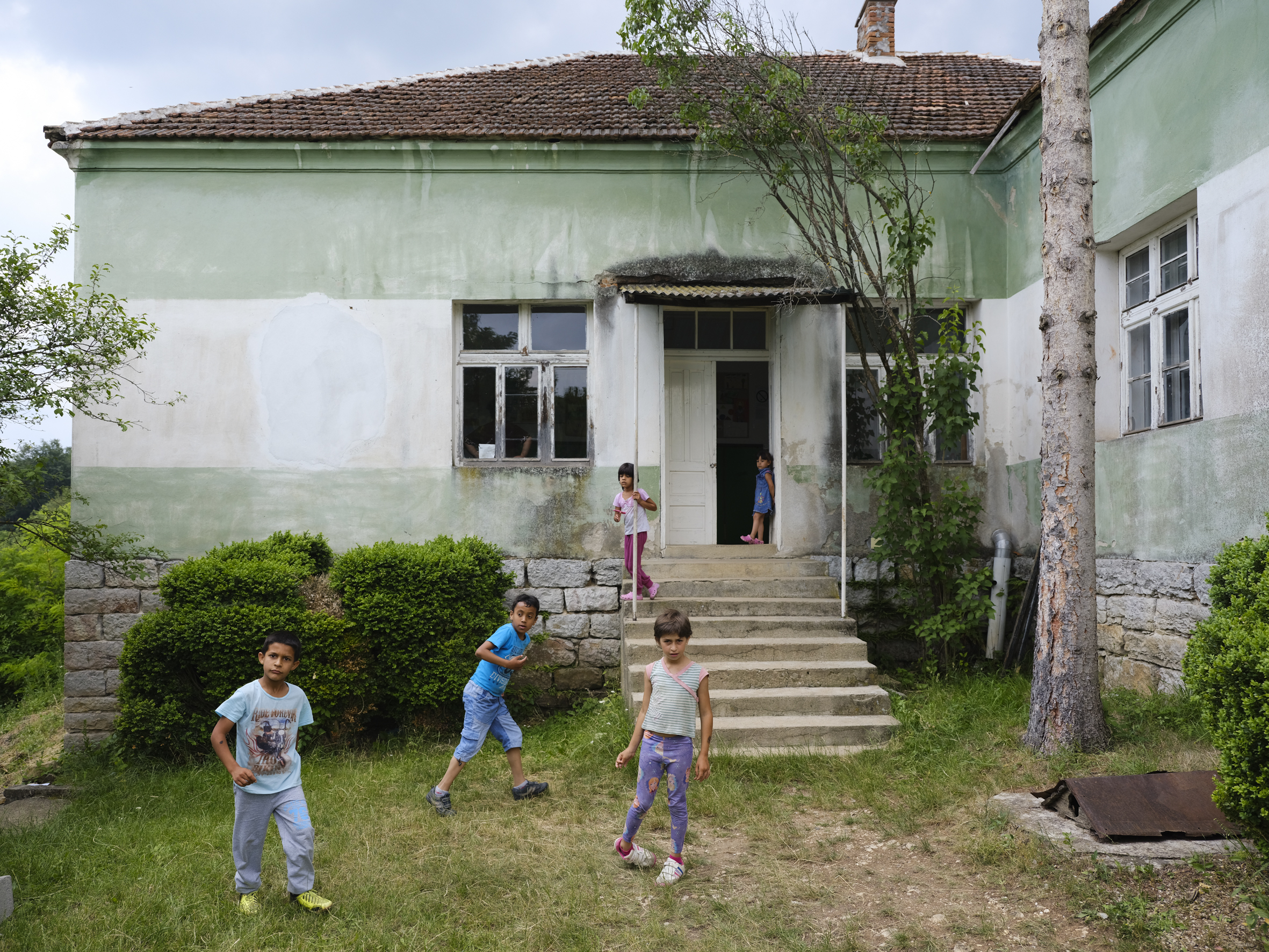 The village school in Babusnica has seven students, all from Roma families. The school is quite a way above the village and doesn't have a toilet.