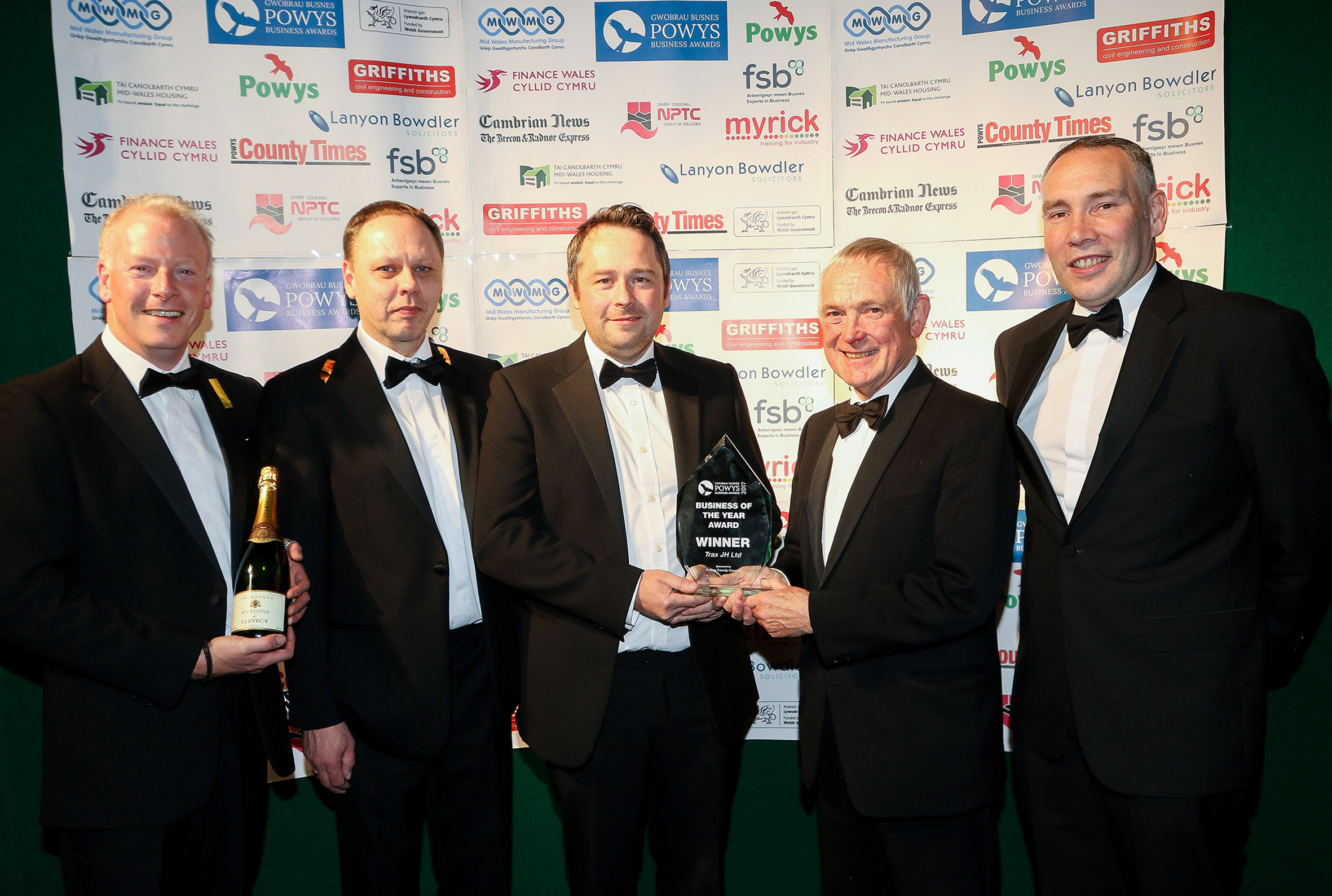 Adam Watkin and his Trax JH Ltd team receiving the Powys Business of the Year 2017 award from John Brunt of Mid Wales Manufacturing Group.