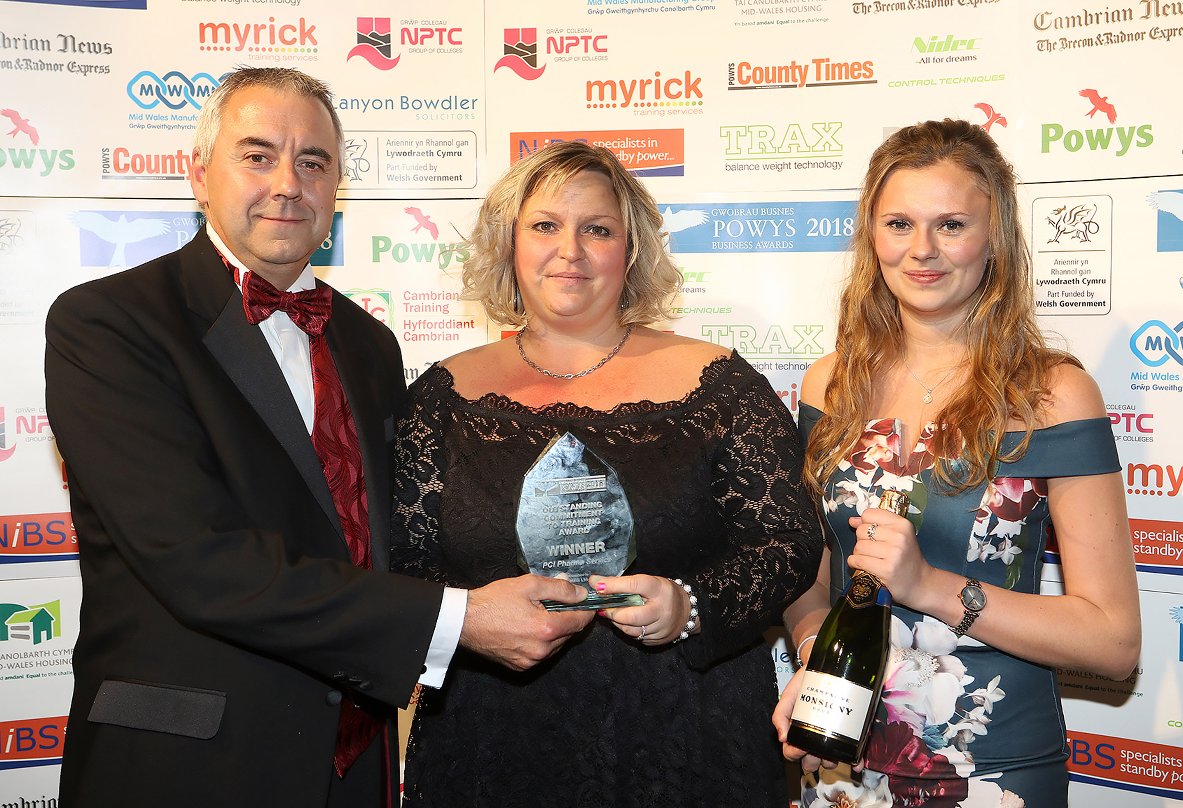 PCI Pharma Services' training supervisor Tracey Lewis and account manager Paige Morgan receive the Outstanding Commitment to Training Award from Chris Gilliard of NiBS Ltd, sponsor.