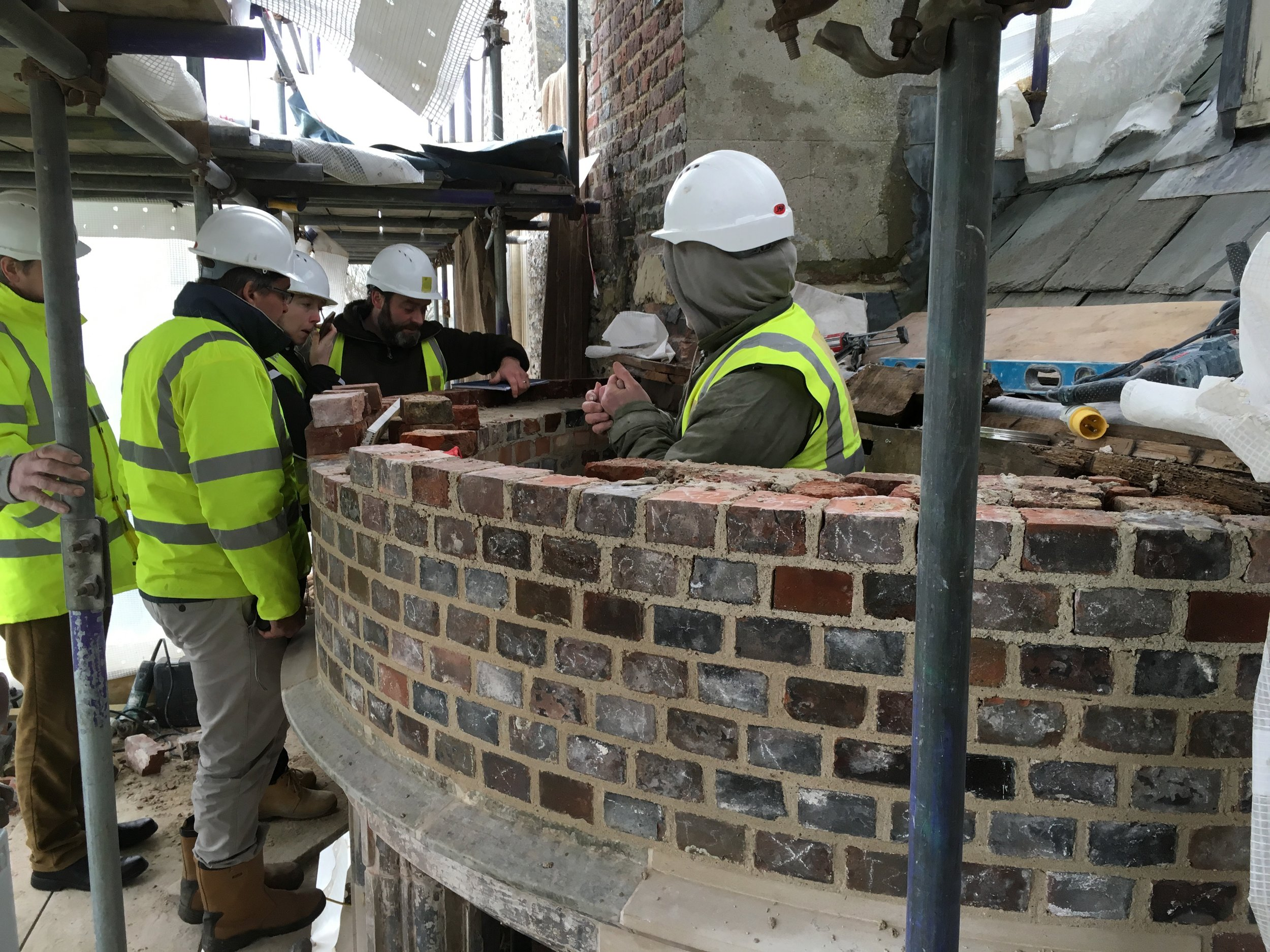 Glynde Place - Phase II - Bay windwo being built back up.jpg