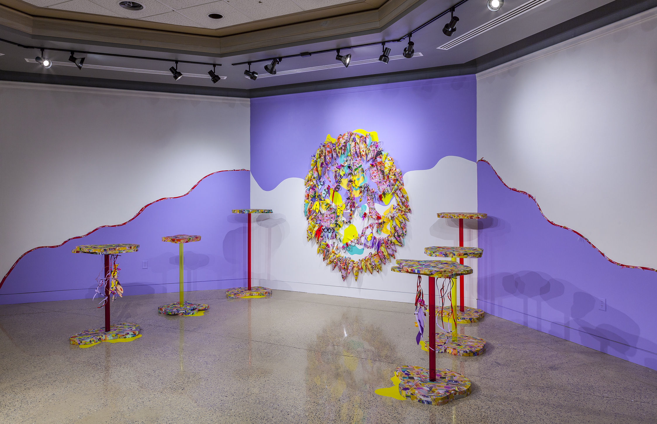 Above and below: Amy Boone-McCreesh. Depictions of Power. 2017. custom fabric, vinyl, mixed media garlands Pillars: Acrylic, foam, custom fabric, mixed media garlands, floor vinyl 7' h x 13' w x 10.5' d Pillars range from 3.3' to 4.5'
