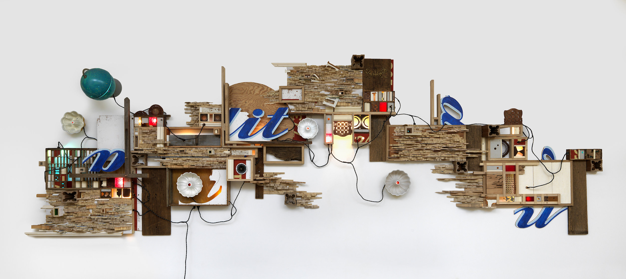 "Above: Juan Angel Chavez,  DRIP FALLS , 2012, mixed media assemblage, 20 ft W x 6 ft x 12 in D. Below: Juan Angel Chavez,          0     0     1     9     53     MSU-Mankato     1     1     61     14.0               96                Normal     0                     false     false     false         EN-US     JA     X-NONE                                                                                                                                                                                                                                                                                                                                                                                                                                                                                                                                                                                                                                                                                                             /* Style Definitions */ table.MsoNormalTable 	{mso-style-name:""Table Normal""; 	mso-tstyle-rowband-size:0; 	mso-tstyle-colband-size:0; 	mso-style-noshow:yes; 	mso-style-priority:99; 	mso-style-parent:""""; 	mso-padding-alt:0in 5.4pt 0in 5.4pt; 	mso-para-margin:0in; 	mso-para-margin-bottom:.0001pt; 	mso-pagination:widow-orphan; 	font-size:12.0pt; 	font-family:Calibri; 	mso-ascii-font-family:Calibri; 	mso-ascii-theme-font:minor-latin; 	mso-hansi-font-family:Calibri; 	mso-hansi-theme-font:minor-latin;}      WOLFDOG , 2010, mixed media assemblage, 5 ft W x 5 ft H x 6 in D. Photos courtesy of the artist"