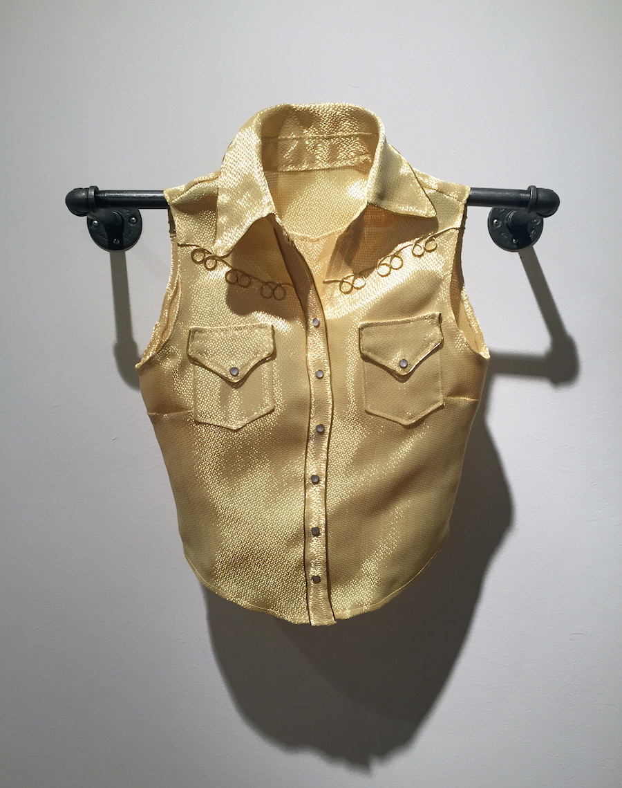 "Above: Erika Diamond,  The ""Lisa"" Vest , twill weave kevlar (bulletproof) fabric, pearl snaps, gold piping, 2018. Below: Erika Diamond,  The ""J"" Hoodie Vest , ballistic grade kevlar (bulletproof) fabric and jersey lining, 2018. Photos courtesy of the artist"