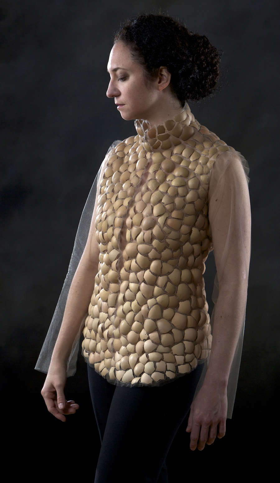 "Above: Erika Diamond,  Eggshell Garment for Hugging II , eggshells stitched between layers of tulle; hugs; 2015, Garment worn to record imprint of hugs; Performance pending. Photo: Zaire Kacz Photography. Below: Erika Diamond,  The ""Spider"" Vest,  hand-woven kevlar (bulletproof) thread bobbin-lace, 2018. Photo courtesy of the artist."