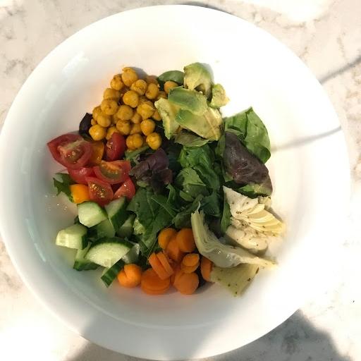 Pictured: Cucumber, tomato, carrots, artichoke hearts, avocado, garbanzo beans