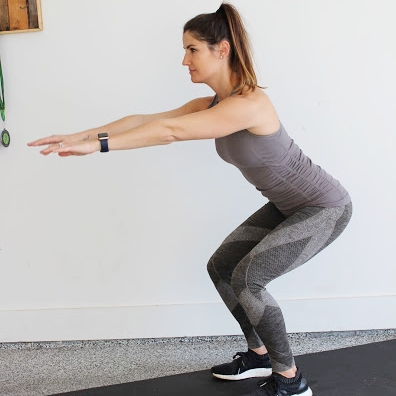 Air Squat - Stand up straight with your feet about hip width apart.Sit back into your heels and lower into a squat.Drive through your heels and stand back up into the start position.Drop straight down and repeat as fast as you want.