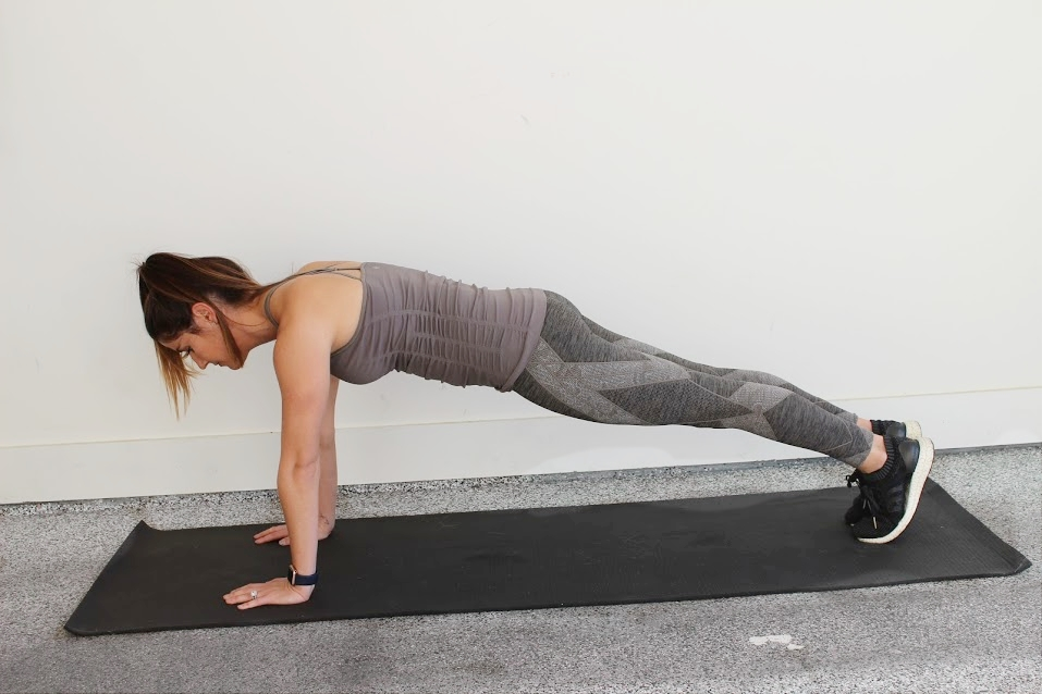 Plank - Start with your hands and knees on the ground.Lift your knees off the ground, and push your feet back, bringing your body into a full extension.Shift forward onto your toes, and act as if you are pushing the ground away. Hold.