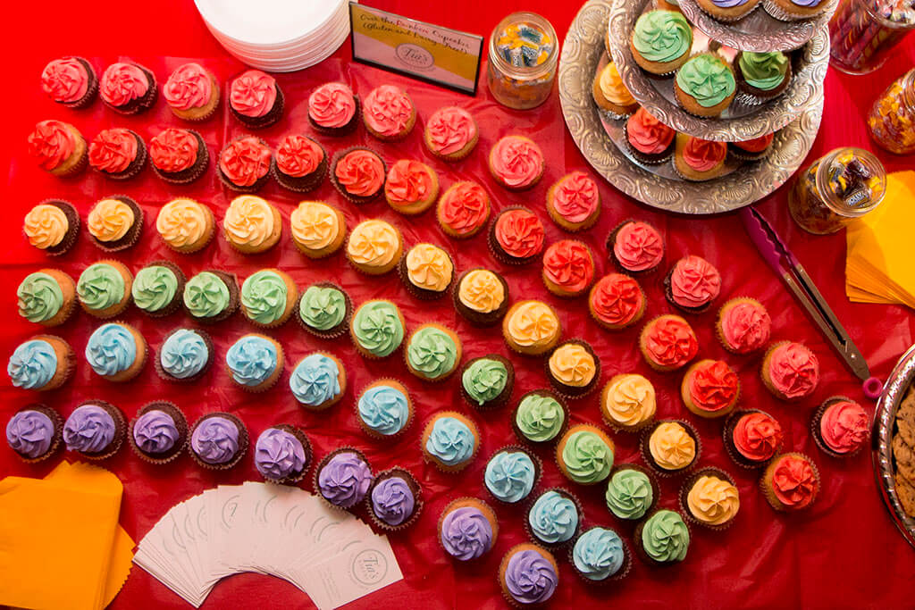 Whimsical Rainbow Cupcake Display on Dessert/Sweets Table - Historia Wedding and Event Planning