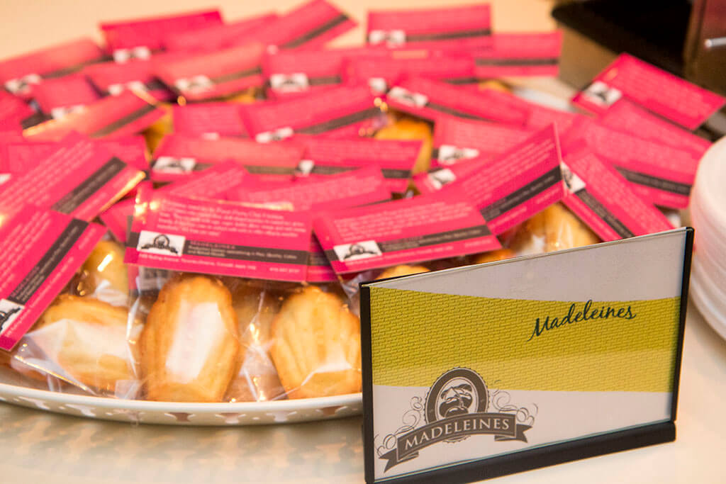 Closeup of packaged Madeleine cookies and sign from Madeleines Bespoke Pastry - Historia Wedding and Event Planning