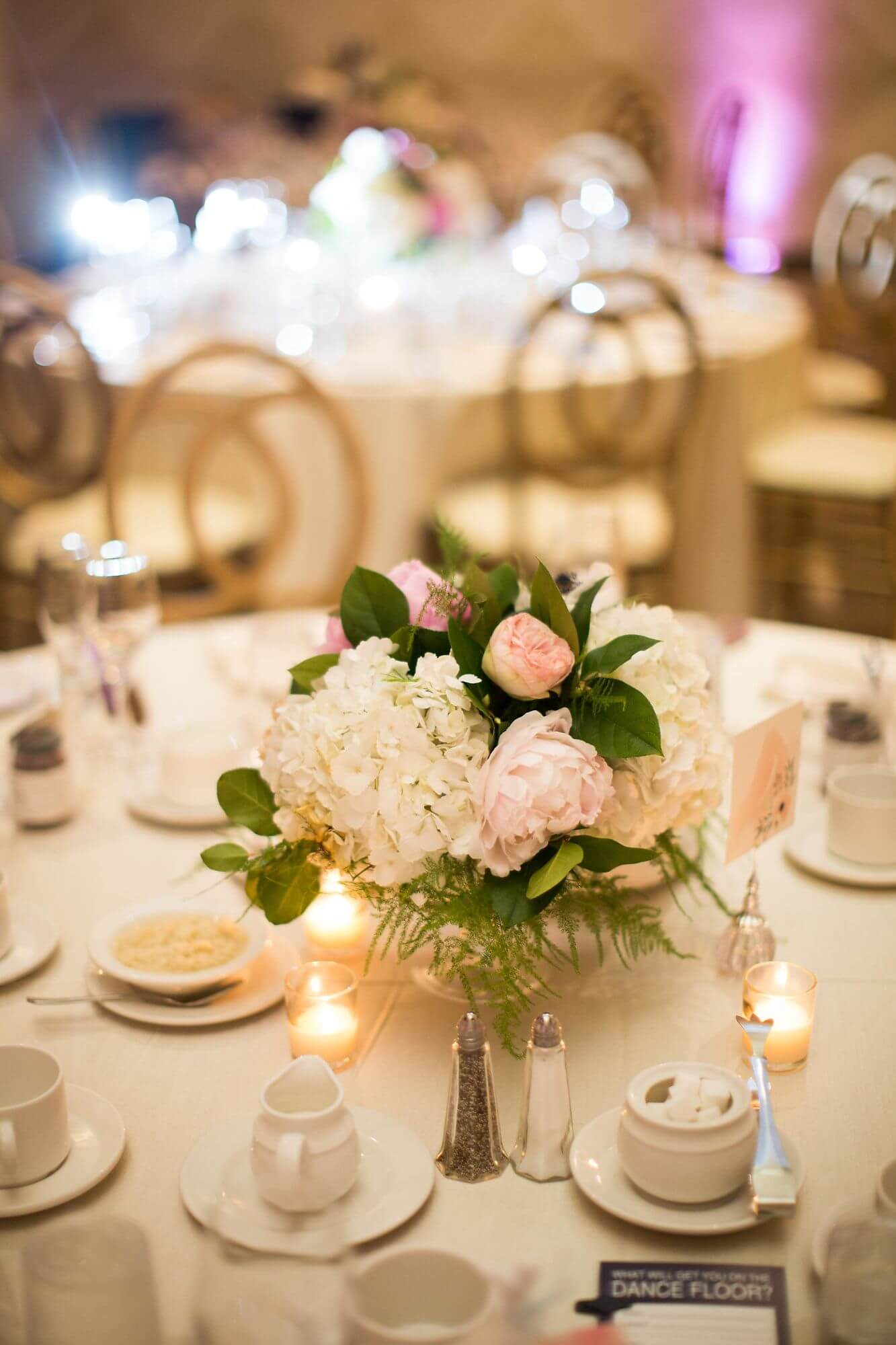 Banquet table with white and blush floral centrepiece - Champagne, Blush and Gold Niagara Wedding - Historia Wedding and Event Planning