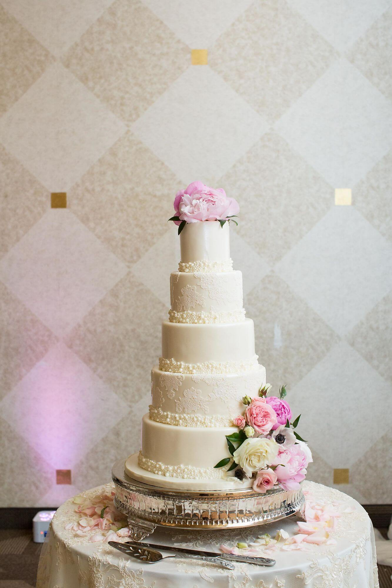 5-tier elegant white wedding cake with pink and white floral topper and accents - Champagne, Blush and Gold Niagara Wedding - Historia Wedding and Event Planning