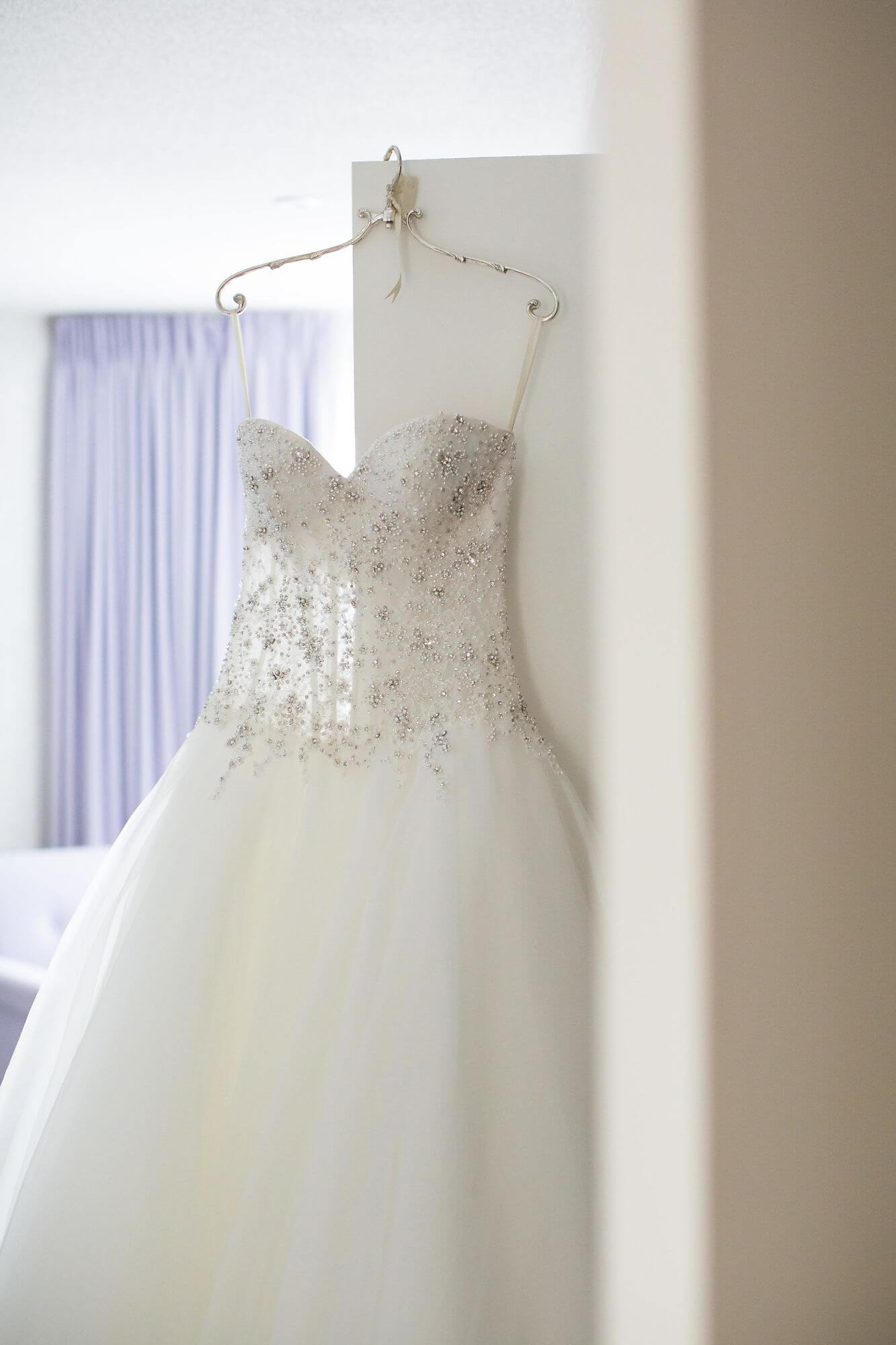 Bridal gown hanging on doorway - Niagara wedding - Historia Wedding and Event Planning