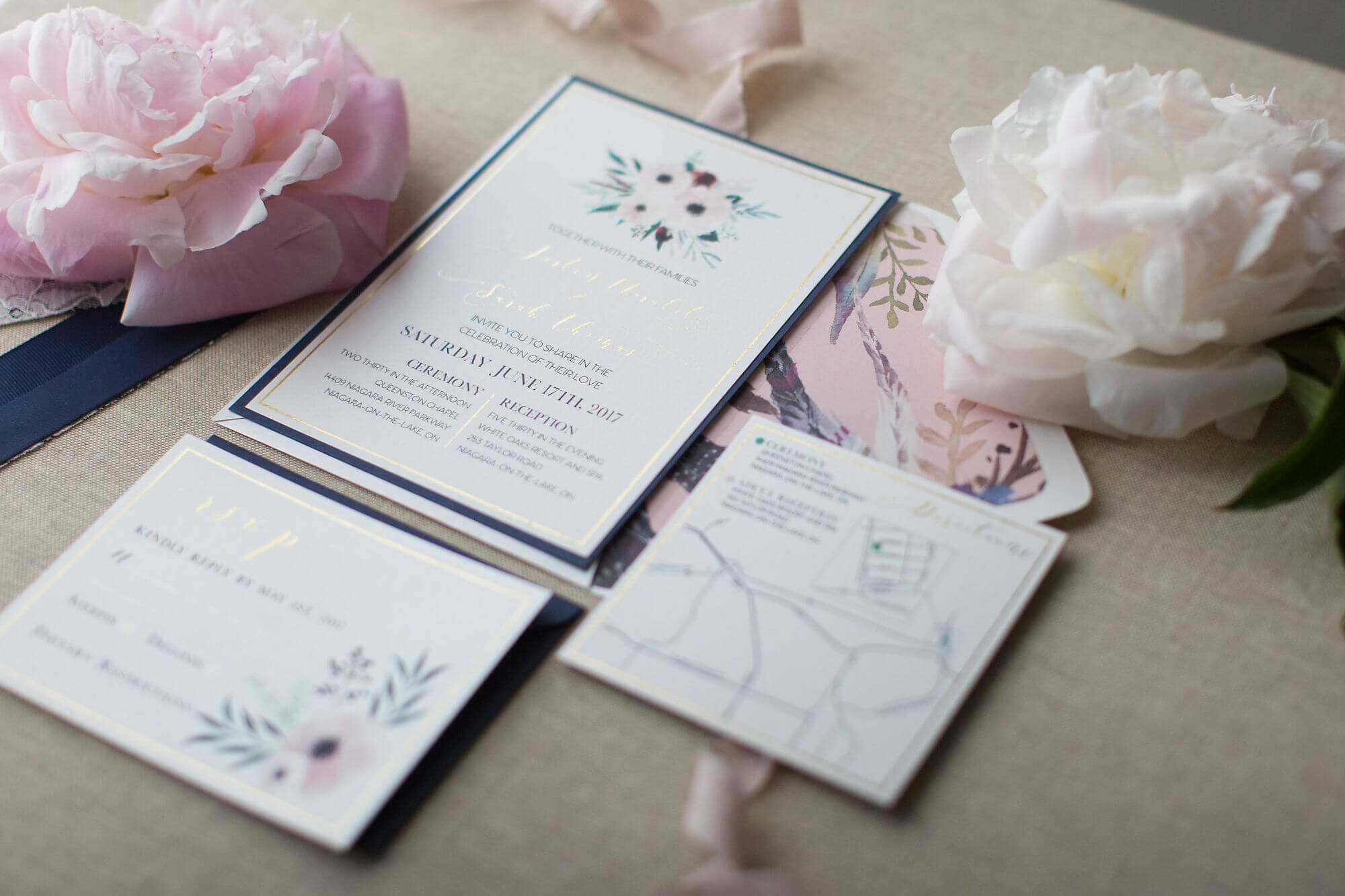 Artistic photo of white, navy, champagne, blush and gold wedding invitations - Niagara wedding - Historia Wedding and Event Planning