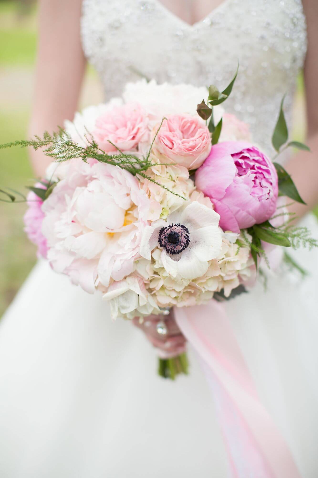 Photo torso closeup of bride in wedding dress holding white and blush pink bouquet with peonies - Niagara wedding - Historia Wedding and Event Planning