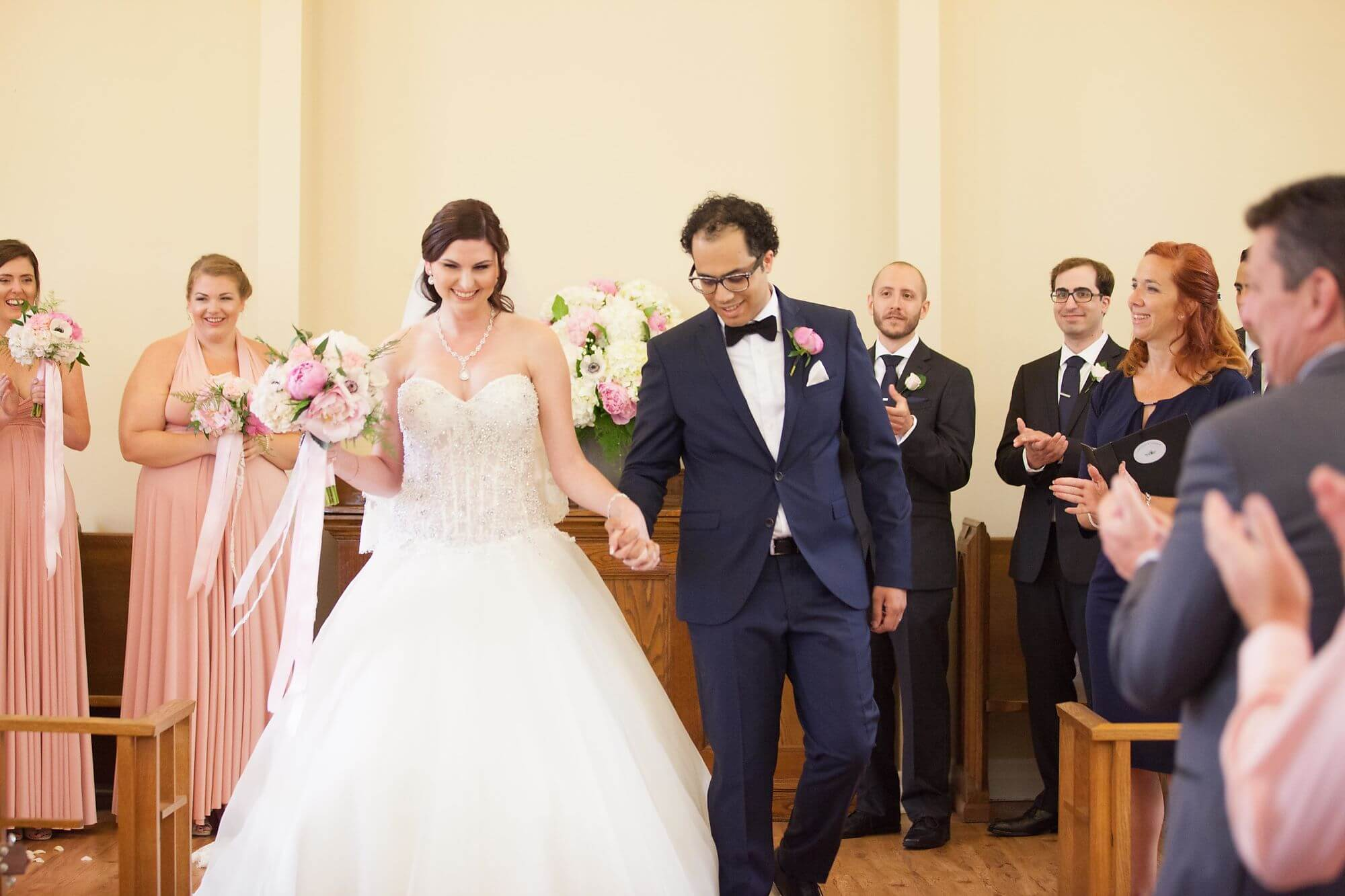 Bride and groom leaving altar after just getting married at Queenston Chapel - Niagara wedding - Historia Wedding and Event Planning