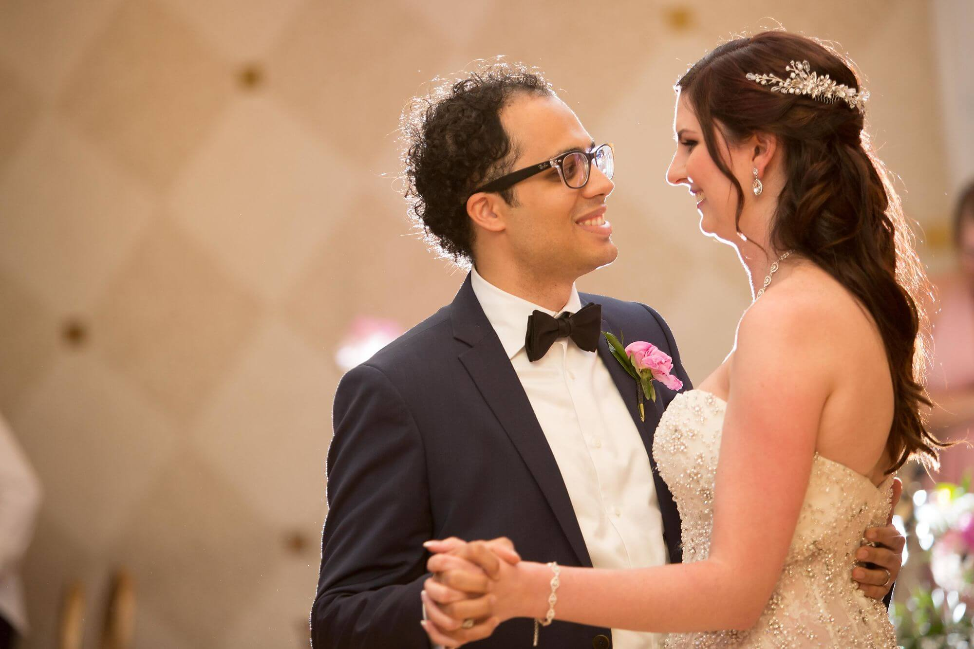 Photo of upper half of bride and groom dancing at wedding at White Oaks Resort - Niagara wedding - Historia Wedding and Event Planning