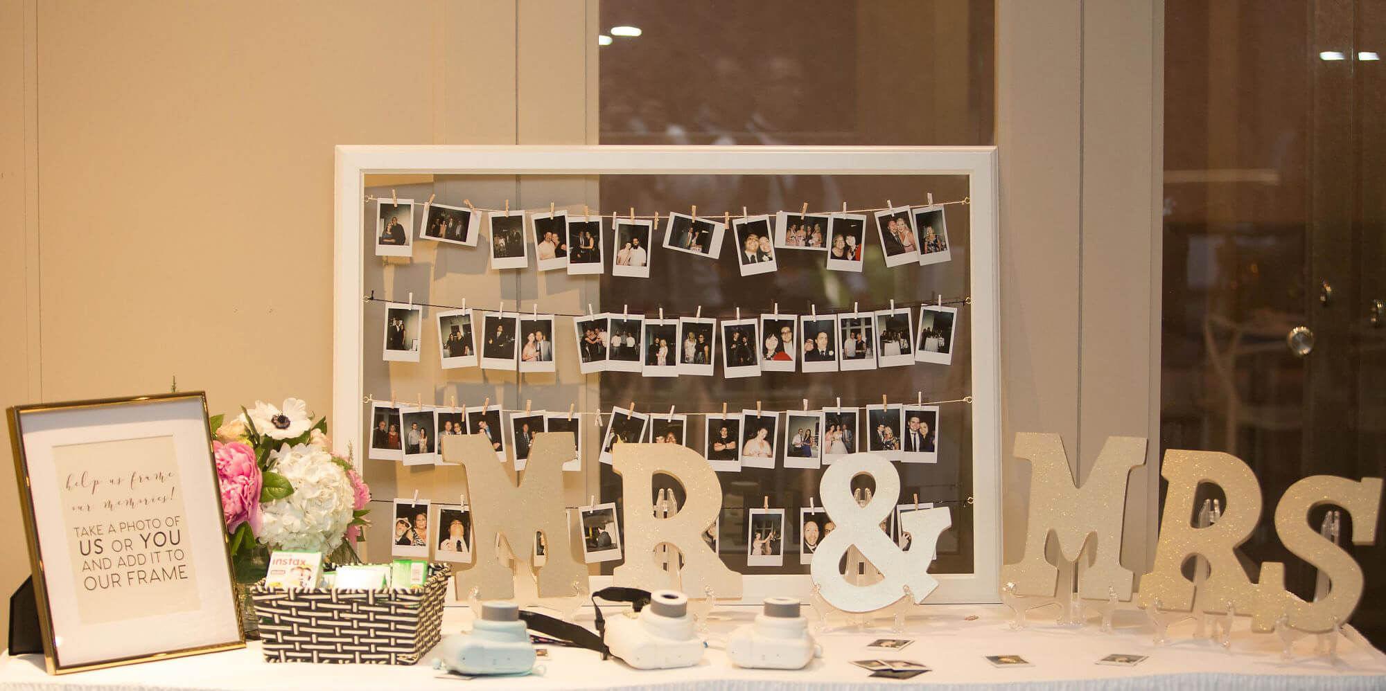 Photo booth wedding table with polaroid photos in frame, Mr. and Mrs. letters and framed quote - Champagne, Blush and Gold Niagara Wedding - Historia Wedding and Event Planning