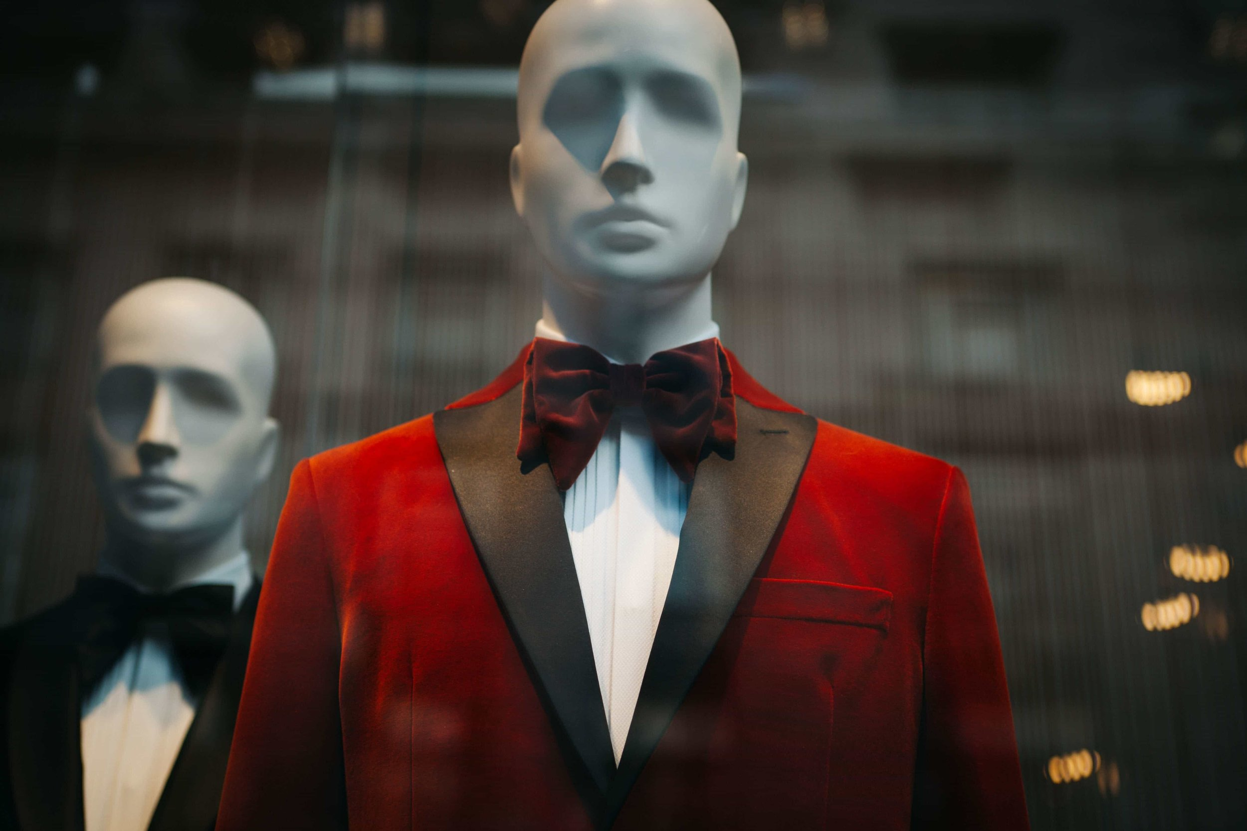 Unconventional red tuxedo with bowtie on mannequin